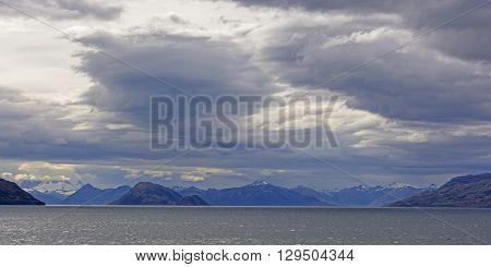 Storm Clouds over Ocean Fjords in Tierra del Fuego in Chile