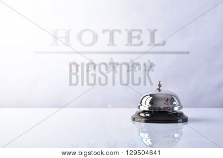 Service Bell On Hotel Reception With Hotel Placard Background