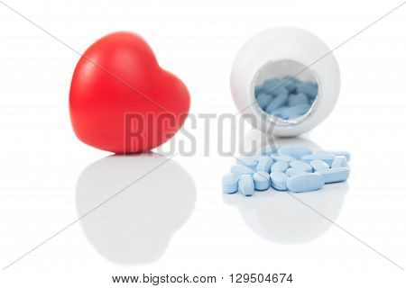 Close Up Toy Heart And Pills On White Background - Studio Shot