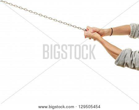 Closeup of mountaineer hiking climbing rock mountain. Human hands holding chain rope. Scrambling mountaineering. Active lifestyle adventure. Isolated on white background.