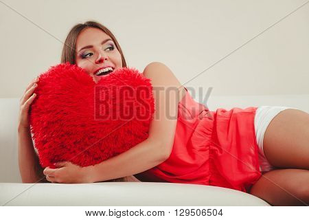 Woman Hugging Heart Shape Pillow. Valentines Day.