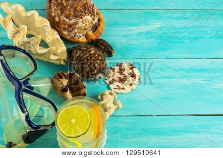 Seashells and beach cocktail background. Beach cocktail. Beach party. Beach drink. Tropical relax.