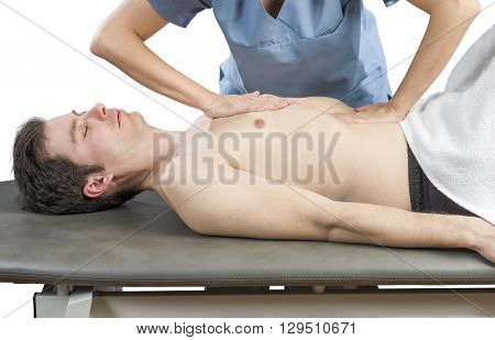 Physiotherapist Is Doing An Activation Of The Diaphragm. Massage To A Man Patient..