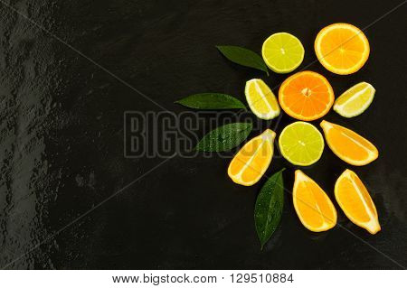 Citrus fruits on black background. Fresh food. Ripe fruit. Citrus fruit. Vegetarian food. Mixed fruit. Fresh fruit.