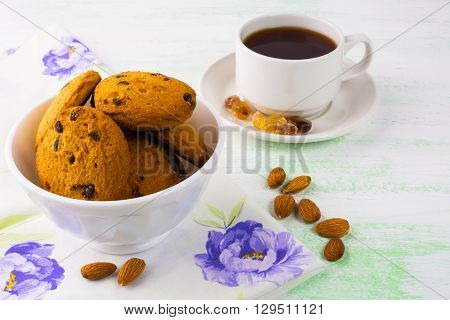 Homemade cookies almond and tea. Sweet dessert. Homemade biscuit. Breakfast cookies. Tea cup. Tea time. Homemade cookies.