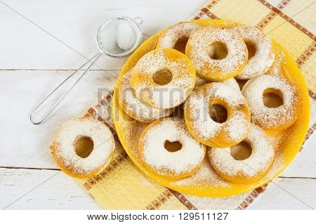 Homemade donuts on yellow plate. Sweet dessert. Sweet pastry. Doughnuts. Donuts.