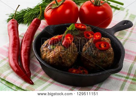 Meatballs served in a cast iron skillet. Turkish meatball. Meatloaf. Grilled meatballs. Meatballs.
