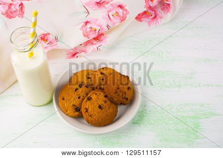 Milk bottle with straw and cookies. Breakfast cookies. Sweet pastry. Sweet dessert. Homemade cookies