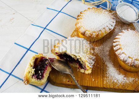 Small sweet pie on the cutting board. Jam pie. Small pie. Pie. Sweet pastry. Sweet dessert