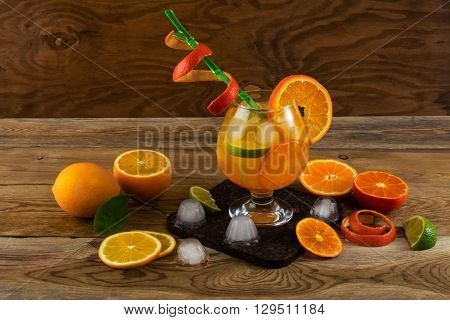 Summer citrus cocktail on wooden table. Fruit cocktail. Fruit drink. Citrus lemonade. Fruit lemonade. Summer drink