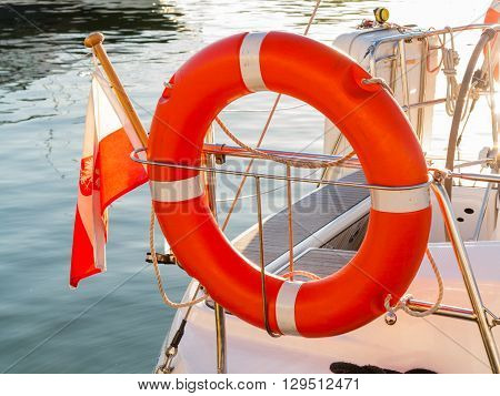 Lifebuoy On Sailboat And Polish Ensign