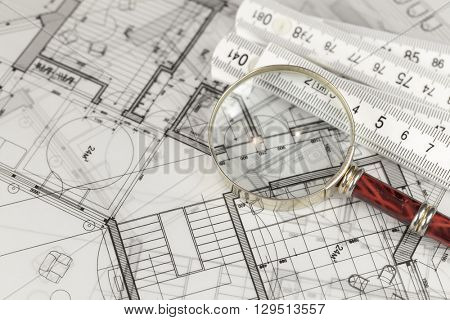 architecture blueprints - house plans, magnifying glass & folding ruler