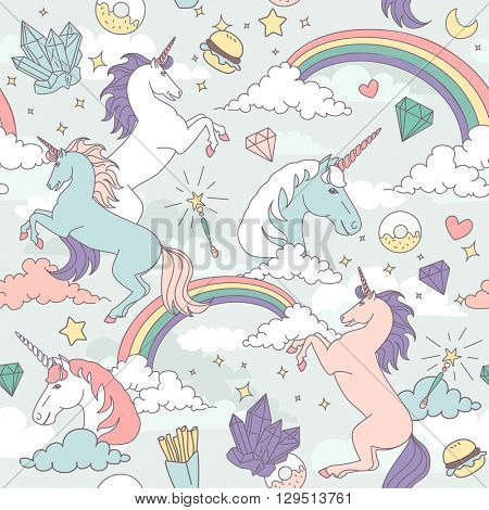 Cute Seamless pattern with unicorns, rainbows, clouds, stars and crystals