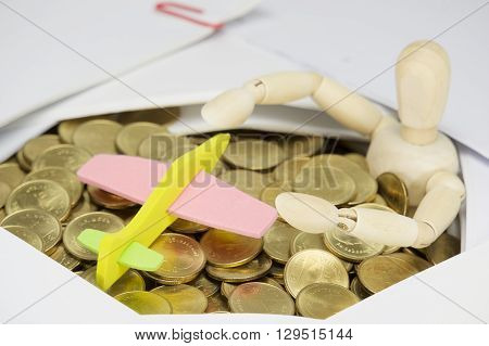 Airplane And Wooden Dummy Surrounded By Stack Of Gold Coins