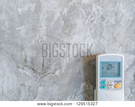 Air Condition Remote on Loft Style Wall Background with Copy Space Minimalist Style