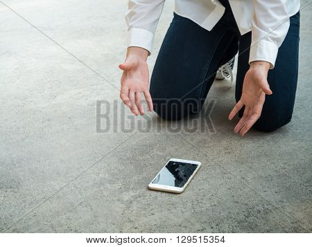Felling Sad Person Droped Smartphone on Floor with Copy Space