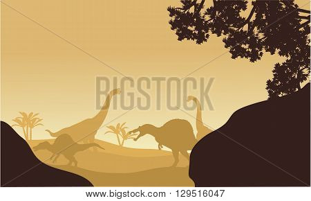 Silhouette of Brachiosaurus and spinosaurus at the afternoon