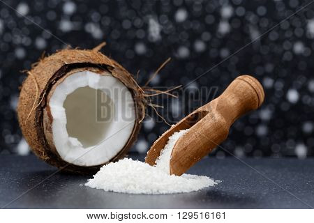 Fresh coconut and coconut desiccated on a stone table