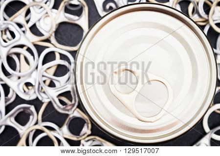 Ring pull cans opener on black metallic background