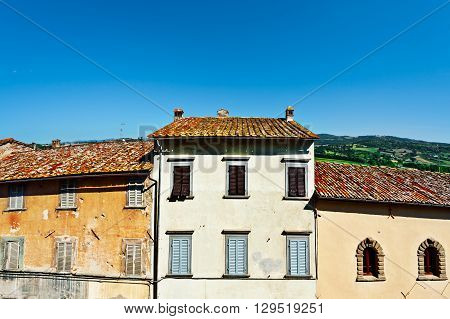 Facades of Old Italian Houses with Crumbling Plaster