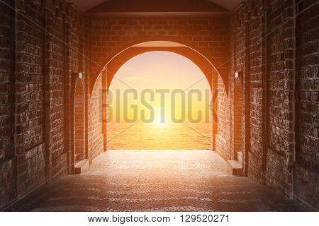 Walkway Tunnel Made By Red Brick And View Of Sunset Or Sunrise