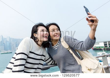 Two woman taking selfie in victoria harbor