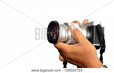 Image of hand holding digital camera over white