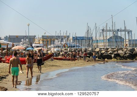 Viareggio Italy - June 28 2015: People resting on the beach. Viareggio is the famous resort on the coast of the Ligurian Sea