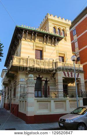 Viareggio Italy - June 28 2015: Old-style design house in city centre. Viareggio is the famous resort on the coast of the Ligurian Sea. Province Lucca Tuscany region of Italy