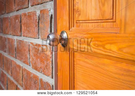 Metal Silver Doorknob On Wooden Door