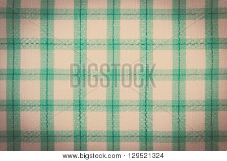 Vintage photo Colorful fabric as background checkered tablecloth texture as backdrop