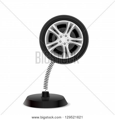 Table souvenir in form of car wheel on spring