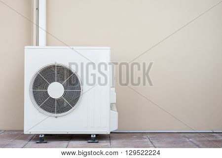 Air Conditioning Compressor Near The Wall