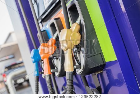 Colorful Fuel Pumps/fuel Nozzle At Gas Station