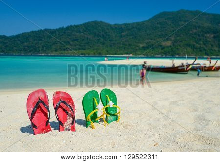 Colorful flipflop sandals on sea beach, Thailand