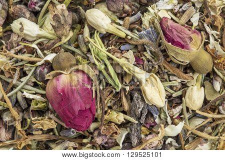 Closeup of healthy skin herbal tea, a blend of  red rose bud. peach flower, lavender, rosemary, honeysuckle