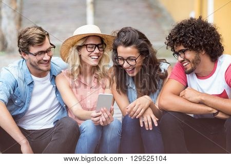 Group of friends interacting using mobile phone