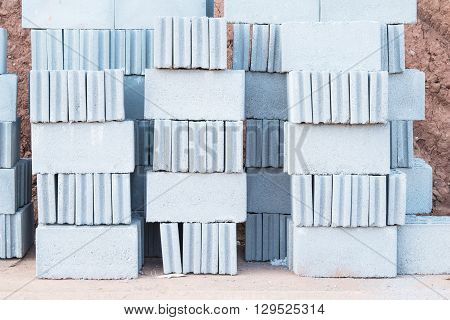 construction cement site concrete stack block background material gray brick cinder stone industry industrial many heap masonry brickwork rubble texture wallpaper backdrop architecture