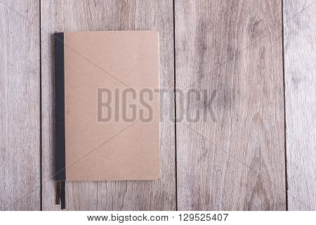 Top View Of Book On Old Wooden Plank