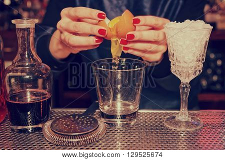 Bartender is adding egg white to the glass, toned image