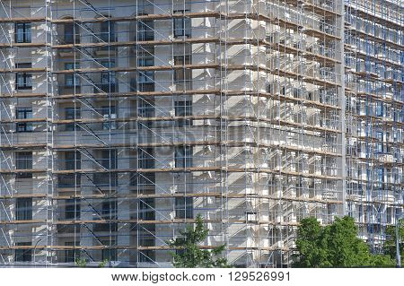 The Facade Of A Large Multi-storey Building In Scaffolding..