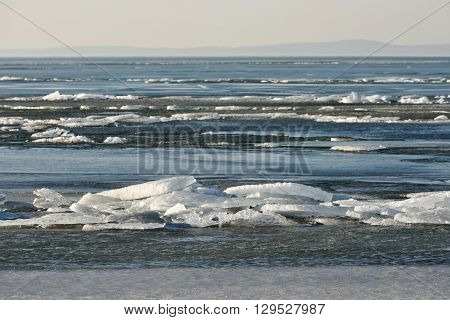 Ice on the surface of The Curonian Lagoon. The Curonian Lagoon is separated from the Baltic Sea by the Curonian Spit