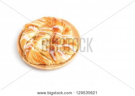 Close Up Danish Pastries On Wooden Dish Isolated On White