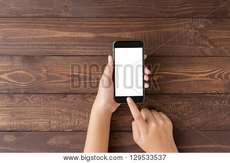 hand using phone blank screen on top view angle