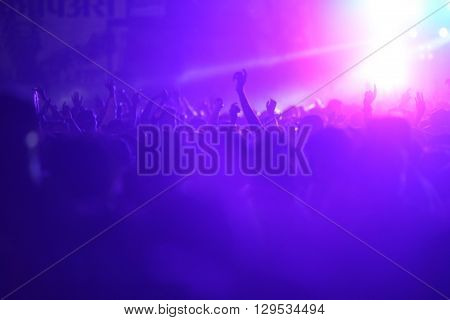 People dancing and enjoying at a huge musical concert in India.