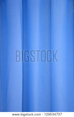 close up blue curtain or drapery background