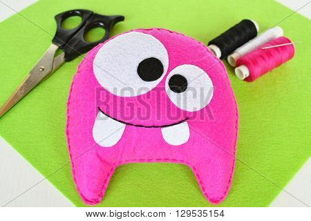 Pink felt monster. Fun baby soft toy