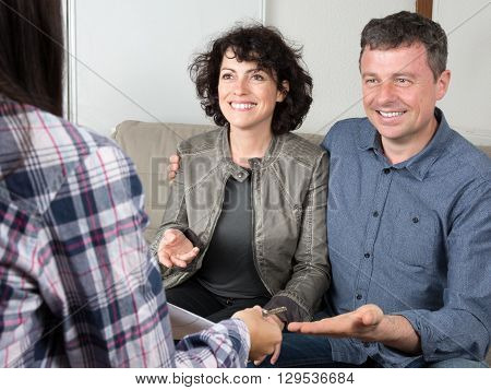 Happy Middle Aged Couple Buying New Home With Agent