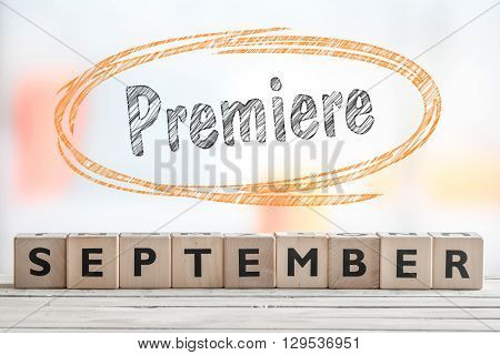 September premiere event sign on a wooden stage