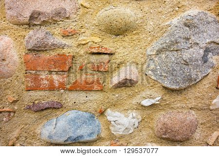 abstract spotty texture of an old stone wall for wallpaper and for a background